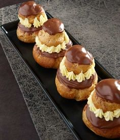 RELIGIEUSES AU CHOCOLAT~ a tradition French pastry~ Choux pastry (cream puffs) are filled with chocolate pastry cream, topped with a smaller Choux, glazed and decorated. The resulting pastry resembles a nun, member of a religious order. Dessert Chef, Dessert Recipes, Sweet Recipes, Whole Food Recipes, French Patisserie, Patisserie Design, Patisserie Vegan, Patisserie Cake, Decoration Patisserie