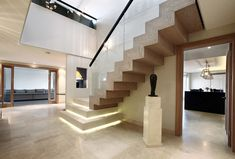 Wood glass railing staircase contemporary with large hall large hall