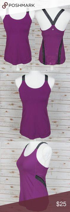 """Lululemon Criss Cross Tank Top Purple Grey Size 8 Gorgeous top from Lululemon! This Criss Cross tank top features thick heather grey straps that cross in the back. Plain front with mesh back panel that includes a pocket. Magenta purple. Includes a built-in bra (and inserts) for extra support - clips in various sizes for ultimate comfort.   Beautiful condition. No flaws or damage.   Size: Lululemon Size 8 - Approximately a Medium.  Measurements (flat across): 15-17"""" chest, 25"""" length…"""