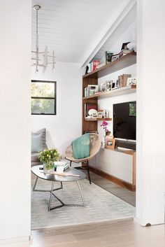 I like the TV wall/cupboards/shelving. Home Tour: Inside An Interior Designer's Midcentury Renovation via @domainehome
