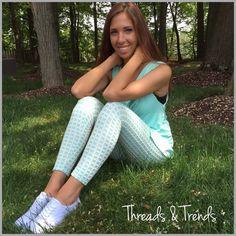 "Mint Gingham Printed Leggings Gingham patterned leggings and sleeveless tunics...super cute for spring & summer. Leggings made of poly/spandex inseam 28.5"" Sleeveless tops made of rayon/spandex. Each sold separately. Pants Leggings"