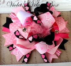 Very cute Valentine bow.  Unfortunately, I just got rid of a lot of cute ribbon, since Sarah won't wear the bows.