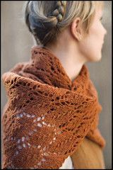 A design inspired by the falling leaves of Autumn. The color was inspired by the same. This rectangular lace stole is worked in two separate halves. The first half is cast on at the outer edge and worked in towards the center. After the first half is complete, stitches are put on a holder and the second half is worked in the same manner as the first. After both halves have been completed, the live stitches from both sides are grafted together invisibly using Kitchener Stitch (see schematic…