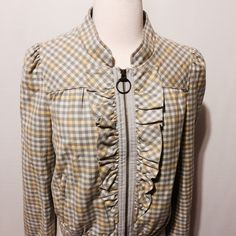 """Amazing Grey Checked Cotton Bomber Jacket Fantastic spring addition to your wardrobe! This gray and yellow check jacket is a must have. Featuring exposed zipper closure, ruffle details at center front, front and back yoke, banded hem and cuffs. Zippered welt pockets. Fully lined. 40"""" bust 21"""" overall length 100% cotton lining 100% poly Hand wash Idra Jackets & Coats Blazers"""