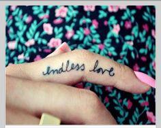 Finger tattoo: endless love