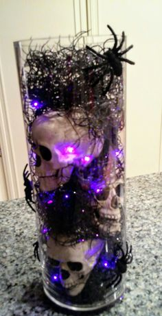 Made for Halloween party. Glass cylinder is 15 tall and 17 circumference. Skulls, spiders and black coiled Spanish moss (plastic) has purple glitter on it. All purchased at Michaels. Halloween Birthday, Diy Halloween Decorations, Halloween House, Baby Halloween, Holidays Halloween, Halloween Themes, Halloween Crafts, Halloween Centerpieces, Halloween Floral Arrangements