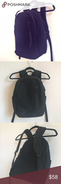 Everlane Mod Commuter Backpack + FREE V-neck Tee! Everlane Black Modern Commuter Backpack - basically new, no signs of wear. Super sleek and functional. Giving away a FREE size small Everlane black v-neck t-shirt with this purchase—100% cotton, super comfortable. I've worn the t-shirt a handful of times.  Take a look at the Everlane website for more specific info on the styles (Modern Commuter Backpack, Women's Cotton V) Everlane Bags Backpacks