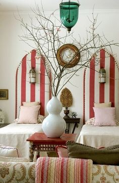 Tall Upholstered Twin Headboards with a lantern and bold stripes and brass upholstery tacks by may