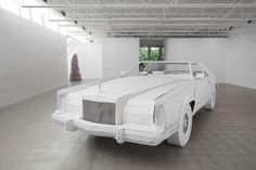 Artist Creates Full Scale 1979 Lincoln Continental Made Entirely of Cardboard. Seriously amazing.