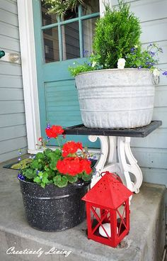 Cute porch, I actually use these things to decorate my place with.  They make beautiful planters! Notice the insulater glass on the wall.  You can usually find black wrought iron holders for these and use them for candle holders!