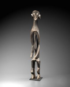 Ancestor Statue People Mumuye, southern Kunini River Adamawa Province  Nigeria  Wood, kaolin  Height: 116 cm.