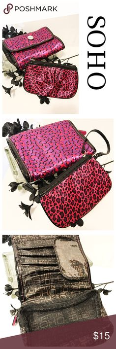 SOHO Toiletry Bag and Wristlet Hot pink hanging toiletry bag with purple leopard print like spots.  Nylon and mesh interior with multiple pockets.   Ones with almost matching Wristlet Bags Cosmetic Bags & Cases