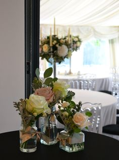 Jam Jars of flowers and candelabras at Russets Country House wedding venue, created by Eden Blooms Florist