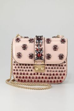 This cute bag looks like it has little jeweled bugs all over it. Valentino