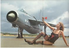 English Electric. Squadron Leader Carruthers missing the tightness imposed by g-force liked nothing more than to strap on a corset, pull up some stockings, force on 9 inch high heels and slide into black satin knickers and tan on the runway as he awaited the next order to scramble!