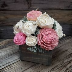 Beautiful Sola Wood Flower design by @pinkliondesignco  Recreate this look:  Flowers have been dyed a pretty pink and left their natural white.  Add a little greenery using preserved boxwood, eucalyptus, or juniper, and arrange it in a stained wooden box.  #flowers #solaflowers #ecoflowers #everlastingflowers #diybouquets #driedflowers #woodflowers #woodroses #diycrafts #homedecor #decorating #bouquet #centerpieces #wreaths #foreverflowers