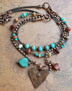 Pretty multi-strand neckalce with a hammered heart pendant #handmade #jewelry #beading