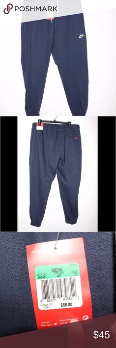 """NWT Mens Nike Blue Navy Cuffed Jogger Sweatpants Nike AW77 Fleece Cuffed Men's Sweatpants Obsidian Navy 598871-451 XL NWT. Originally priced at $55.00  Made in Malaysia 80% Cotton 20% Polyester  Measurements Waist: 17.5"""" Legs: 30""""  *Comes from a pet free and smoke free home* Nike Pants Sweatpants & Joggers"""