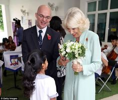 She was greeted with flowers from a young pupil as the school's Principal, Mr Andrew Dalton, took her on a tour of the impressive facilities Camilla Duchess Of Cornwall, Prince Charles And Camilla, Royal Prince, How To Get Warm, Royal Families, Kuala Lumpur, Royals, British, Couples