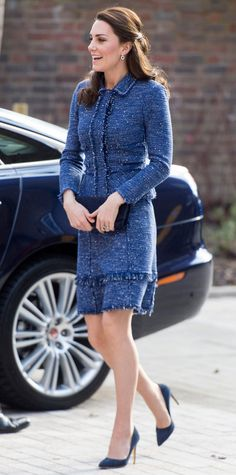 Kate Middleton is a vision, attending the opening of the Ronald McDonald House Evelina London. The Duchess of Cambridge wore a charming navy boucle jacket and skirt set with matching pumps, sleek black clutch, and elegant jewelry.