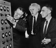 Ernest O. Lawrence, Emmett L. Brown and J. Robert Oppenheimer peer at the controls of the 184-inch cyclotron, which was being converted in early 1946 from its wartime use to its original purpose as a cyclotron.