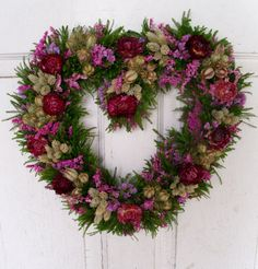 This beautiful heart wreath is made with assorted dried flowers ,statice , nigella, strawflowers and greens.  It measures approx. 14 inch across.