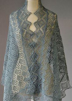Free Knitting Pattern for Whimsical Wrap - Lace shawl designed by Universal Yarn is created with yarn with a metallic shimmer.
