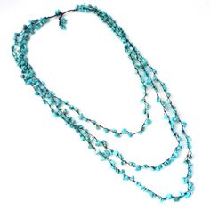 This irresistibly chic yet elegant necklace is made of blue turquoise on cotton rope strands. This necklace was handmade in Thailand by artisan, Jeab.