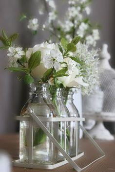 Flowers in Vintage Milk Bottles
