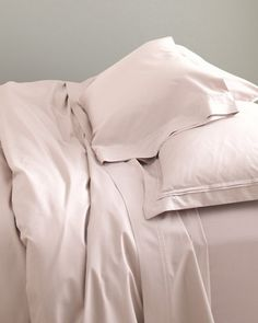 This soft bedding by Eileen Fisher gets its luster from a satin weave that uses finely spun long-staple combed cotton with 400 threads per inch