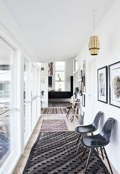 hall with different shapes and pattern rugs