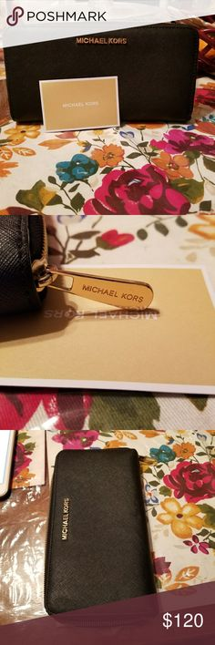 Michael MK woman's jet set travel ZA continental w A sturdy saffiano leather mk wallet with gold polished hardware a wraparound zip reveals a lined interior with a dividing zip pocket and holds 8 slots for credit cards has many pockets Michael Kors Accessories