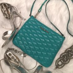 Rebecca Minkoff Love Kerry Quilted Crossbody Beautiful Teal Green Rebecca Minkoff Love Kerry Quilted Crossbody with tassel. Diamond quilted stitching. Dust bag and extra leather tassel included. Lined with signature black and white leopard print. Zipper closure. Rebecca Minkoff Bags Crossbody Bags