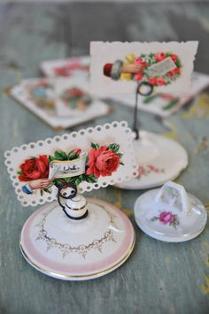 stray lids made into photo holders bowl, name tags, place card holders, place cards, name cards, photo holders, vintage china, tea, table numbers