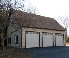 24' x 36' Elite Cape Garage: Smartside siding, Window upgrades, Door upgrades, 30' Shed dormer, 9x8.5 Overhead doors with glass, Taller walls.