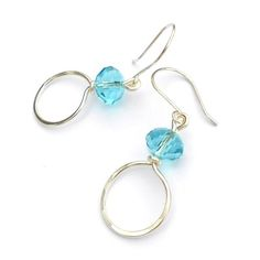 Turquoise Crystal Wire Hoop Handmade Earrings  £10.00  Silver plated (non-tarnish) wire has been hand shaped and hammered and then adorned with turquoise crystal glass faceted beads, on handmade earwires. Drop from ear: apx 1.5 inches.