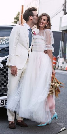 Agyness Deyn ended the season on a high note, marrying over the weekend in a frothy Molly Goddard gown. Perfect for the low-key, intimate setting, the white and pink confection featured tiered organza and lighter-than-air puffed sleeves—a look that's fanciful and romantic, yet inherently polished. Punctuated by simple glam (natural-looking makeup and smooth, unfussy hair) and unexpected turquoise Manolo Blahnik pumps.