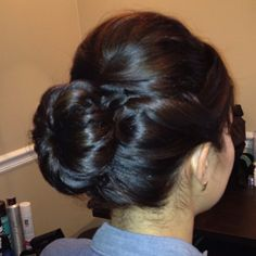Hot bun for bride.  Hair was only just above shoulder length.  Curl ends and tease crown.  Then secure hair in a pony and fan curls outward and secure with pins.