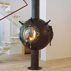 Fireplace made from old Naval mine.