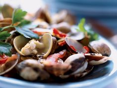 Spicy Clams with Tomatoes | The clams used in Sicily for this dish are tiny vongole veraci. American littleneck clams are too sandy and tough to use here, but the small ridged cl...