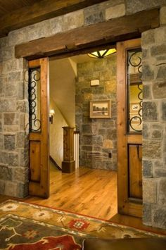 Gorgeous pocket door made of Distressed Alder by Craftsmen in Wood