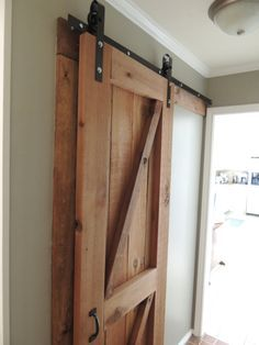 Extensive guide to creating custom, inexpensive barn door hardware.  Seriously, this hardware only cost them $55 to make!