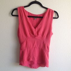Ann Taylor Top ⚡️price dropped⚡️Very cute & sexy top. V neck with amazing neck line. Hidden side zipper & belt to tie at back.  Purchase this & another top listed & save on shipping! Fits Small(4-6).Please always ask me questions before purchasing whether it's Regarding size, color, material, length, condition,bundles,shipping etc. if you purchase without asking then it's understood that you were satisfied with your purchase..thanks!✌️ Ann Taylor Tops