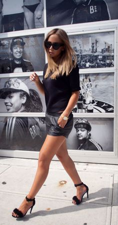Lisa Olsson is wearing short shorts and top from Nelly and shoes from Jennie-Ellen