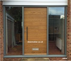 contemporary oak door and hardwood frame with fully glazed sidelights factory sprayed grey