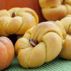Pumpkin Dinner Rolls with Pecan Stems #holidayentertaining #thanksgiving #givingthanks #november #holidays #thanksgivingideas #thanksgivingcrafts #thankful #thanks #thanksgivingrecipes www.gmichaelsalon... #diy #crafting #recipes #forthehome #holidaydecorating #holidaydecor #harvest #autumn