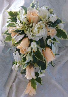 Artificial Peach and ivory wedding bouquet   www.nozzeweddingflowersandfavours.co.uk