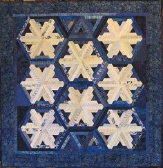 """Snowflakes, 54 x 56"""", quilted by Holly Casey"""