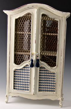 This Armoire is the newest finish (Stone Harbor) in my Not, So Shabby Chic line. The silky blue, cream and beige fabric is wonderful, topped off with