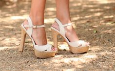 Very high but very cute summer shoes as well ! I'm too tall to wear these unfortunately..